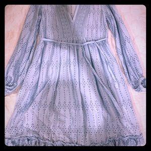 Beautiful light blue eyelit dress slip attached.